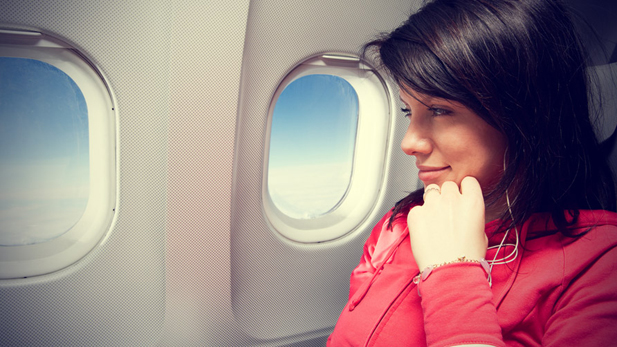 Woman-Sitting-In-The-Airplane
